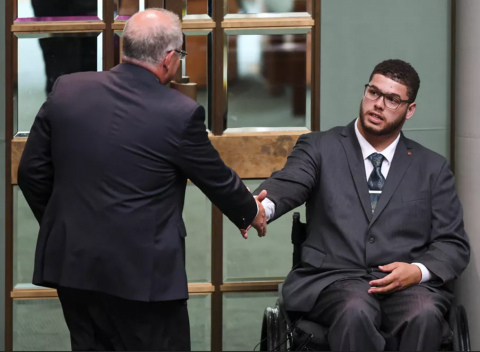Seantor Jordon Steele-John shakes ScoMo's hand as ScoMo leaves before the vote on a Royal Commission