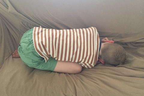 boy lying on floor