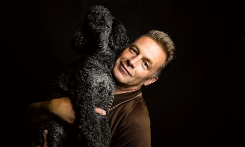 Chris Packham and his black curly-haired dog