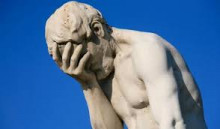 statue of naked disappointed man